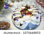 small pastries on mirror tray... | Shutterstock . vector #1070668853