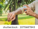 young man spraying mosquito...   Shutterstock . vector #1070687843