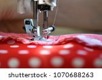sewing machine foot on material ... | Shutterstock . vector #1070688263