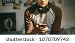 teenage boy in a bedroom... | Shutterstock . vector #1070709743