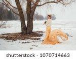 a walk of newlyweds near a tree ... | Shutterstock . vector #1070714663