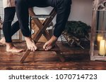 a young enamored guy sits on a... | Shutterstock . vector #1070714723