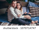 young loving couple sitting on... | Shutterstock . vector #1070714747