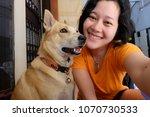 selfie asian woman with dog | Shutterstock . vector #1070730533