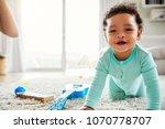 happy mixed race toddler boy... | Shutterstock . vector #1070778707