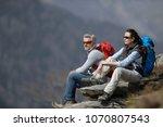 hikers admiring mountain... | Shutterstock . vector #1070807543