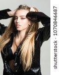girl with long hair wears black ... | Shutterstock . vector #1070846687