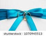 golden wedding rings on blue... | Shutterstock . vector #1070945513