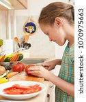 child girl cooking in home...   Shutterstock . vector #1070975663