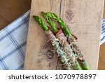 grilled green asparagus wrapped ...   Shutterstock . vector #1070978897