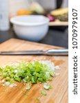 green onion on cutting board   Shutterstock . vector #1070979107