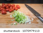 fresh tomatoes and green onion...   Shutterstock . vector #1070979113