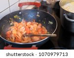 cooking prawns and tomatoes in...   Shutterstock . vector #1070979713