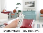 using white remote control.... | Shutterstock . vector #1071000593
