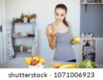 woman holds in hand cake sweet... | Shutterstock . vector #1071006923