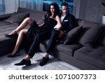 elegant  sensual couple sitting ... | Shutterstock . vector #1071007373