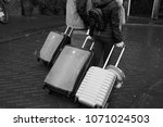 people carrying baggage.... | Shutterstock . vector #1071024503