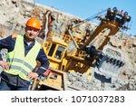 worker in front of heavy... | Shutterstock . vector #1071037283