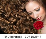 Beauty With Long Curly Hair An...