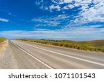 picturesque road on sunny day.... | Shutterstock . vector #1071101543