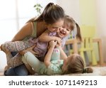 mother with children daughters... | Shutterstock . vector #1071149213