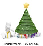 snowy Christmas tree with star on top and full of presents next to a boy opening his gift. - stock photo