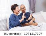 senior asian couple...   Shutterstock . vector #1071217307