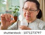 senior woman taking medication  ... | Shutterstock . vector #1071273797