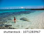 a young woman in blue lagoon in ... | Shutterstock . vector #1071283967