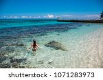 a young woman in blue lagoon in ... | Shutterstock . vector #1071283973