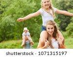 girl is having fun on a hike in ... | Shutterstock . vector #1071315197