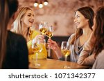 girlfriends drinking wine and... | Shutterstock . vector #1071342377