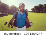 handsome middle eastern golf... | Shutterstock . vector #1071364247