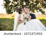 groom took the bride in his... | Shutterstock . vector #1071371903
