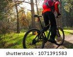 cyclist riding the mountain... | Shutterstock . vector #1071391583