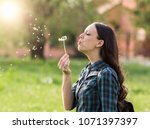 young pretty woman blowing... | Shutterstock . vector #1071397397
