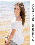 outdoor summer portrait of... | Shutterstock . vector #1071416903