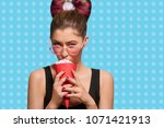 young fancy model eating cream... | Shutterstock . vector #1071421913
