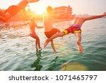 group of happy people having... | Shutterstock . vector #1071465797