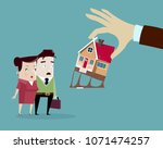 hand takes the house from the... | Shutterstock .eps vector #1071474257