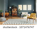 spacious bright bedroom... | Shutterstock . vector #1071476747