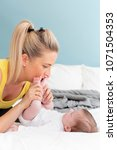 beautiful  young mother with... | Shutterstock . vector #1071504353