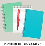 three notepads and a pen.... | Shutterstock .eps vector #1071552887