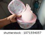 hand carry clothe bag show pink ... | Shutterstock . vector #1071554057