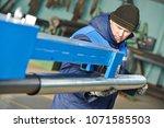 sheet metal folding. industrial ... | Shutterstock . vector #1071585503