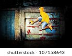 Young man jumping / dancing on grunge graffiti wall background - stock photo