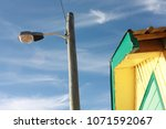 street lamp and yellow house | Shutterstock . vector #1071592067