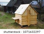 wooden well in the village | Shutterstock . vector #1071632297