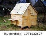wooden well in the village | Shutterstock . vector #1071632627