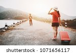 couple tourism backpack walking ... | Shutterstock . vector #1071656117